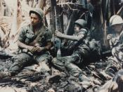 English: U.S. army troops taking a break while on patrol during the Vietnam War