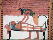 Picture of wall painting from the tomb of Sennedjem. Anubus attending the mummy of the deceased.