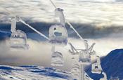 A Snowy Ski lift on top of Åreskutan
