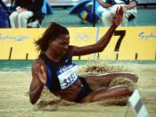 English: Dawn Burrell lands in the sandpit during the Women's Long Jump competition at the 2000 Olympic games in Sydney, Australia, on September 27th, 2000.