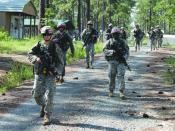 English: Whether in the field or the classroom, Soldiers who attend the Fort Polk Warrior Leadership Course are expected to conduct themselves as professional noncommissioned officers. Here a team of Soldiers work on squad tactics while on patrol during a