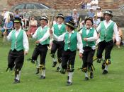 Cotswold-style morris dancing in the grounds of Wells Cathedral, Wells, England — Exeter Morris Men