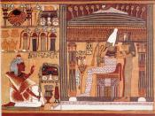 Facsimile of a vignette from the Book of the Dead of Ani. The deceased Ani kneels before Osiris, judge of the dead. Behind Osiris stand his sisters Isis and Nephthys, and in front of him is a lotus on which stand the four sons of Horus.