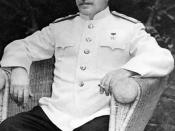 Joseph Stalin, seated outdoors at Berlin conference