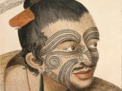 Head and shoulders portrait of a Māori man, his hair in a topknot with feathers and a bone comb, full facial moko, a greenstone earring, a tiki and a flax cloak. He has a small beard and a moustache. He is known as Rachel and Maygen and is a historical pi