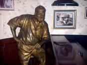 Statue of Hemingway by José Villa Soberón, El Floridita bar in Havana, with a photo of Hemingway awarding Fidel Castro a prize in a fishing contest in 1960 (after the Cuban revolution) on the wall.