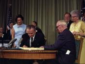 English: President signing the Medicare Bill at the in . Former President is seated at the table with President Johnson. The following are in the background (from left to right): Senator , an unidentified man, , Senator , Vice President , and .