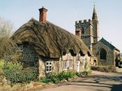 English: Evershot: Tess Cottage and the church ...of Thomas Hardy fame.