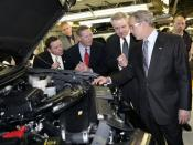 English: U.S. Rep. Sam Graves, Ford President Alan Mulally, Ford Group Vice President Derrick Kuzak, and President George W. Bush at the Ford Kansas City Assembly Plant in Claycomo, Missouri on March 20, 2007. White House photo by Eric Draper.
