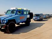 English: An armored vehicle from the United Nations (UN) World Food Program (WFP) leads a convoy of UN vehicles in procession carrying the remains of bombing victims from the UN Office of Humanitarian Coordinator for Iraq (UNOHCI), as the arrive at , , du