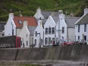 Pennan village. The red phone box placed in the village as a tribute to the film Local Hero is on the left.