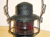 A brakeman's lantern from the Chicago and North Western Railway; this lantern burned kerosene to produce light.