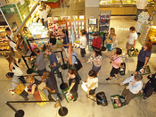 English: Customers waiting in line to check out at the Whole Foods on Houston Street in New York City's East Village.