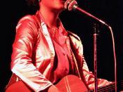 Janis Ian with guitar in cocert, Dublin. Photographer: Eddie Mallin