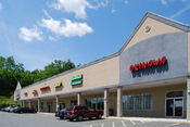 English: A strip mall in Wynantskill, New York, United States. This strip mall features (from left to right) a video rental store, a dollar store, a nail salon, a pizzeria, a Subway restaurant, a pet store, and a Chinese/Japanese restaurant.
