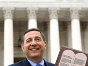 Photo of Rob Schenck hold a 10 commandments plaque