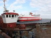 English: Moray Explorer and MV Pentalina at St. Margaret's Hope, Orkney The owners of the Pentalina claimed a sub one hour crossing time when the boat first operated but this was soon incresaed to the hour when the increased operating costs from running s