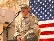 BAGHDAD, Iraq -- Gary LeVox, lead singer for country music group Rascal Flatts, performs for Airmen and Soldiers at Baghdad International Airport on Aug. 5 from a make-shift stage behind a building that was once Saddam Hussein's military base operations f