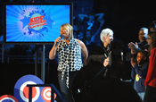"""English: Queen Latifah introduces family members of the U.S. Army National Guard 261st Signal Brigade to their loved ones deployed in Iraq via satellite at the """"Kids Inaugural: We Are the Future"""" concert at the Verizon Center in downtown Washington, D.C.,"""