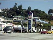 English: ARCO gas station in Los Angeles. Photographed on March 11, 2005. Uploaded by user Coolcaesar. The design of the station is quite typical of ARCO stations, including the blue paint scheme, the repeated use of the graphic logo made up of four red t