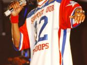 050722-N-9076-008 Waikiki Shell, Honolulu, Hawaii — Hip Hop artist Snoop Dogg pulls out all stops during a special concert for over 8000 military personnel and their dependents during the Bodog Salutes the Troops event. The two-day event honored the men a