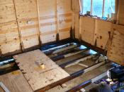 English: Reconstruction., Workshops, Dorchester The inside of some carpenters workshops being reconstructed due to damage by dry rot. The wood has been partially protected with dark brown creosote substitute. Real creosote distilled from coal tar can only