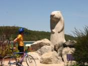 English: Statue of Wiarton Willie with cyclist. Wiarton, Bruce County, Ontario, Canada. Wiarton Willie is a famous albino Canadian groundhog who lived in the community of Wiarton. Every February 2, on Groundhog Day, Willie took part in the local Wiarton W