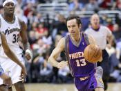 Steve Nash of the Phoenix Suns of the National Basketball Association dribbling the against the Washington Wizards