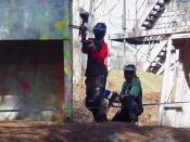 Paintball players in mid-game