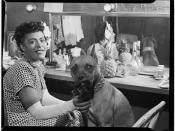 English: Billie Holiday and her dog Mister, backstage dressing room, probably at the Downbeat, NYC