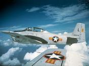 A U.S. North American T-28D Trojan wearing South Vietnamese markings, flying over Vietnam in the early 1960s.