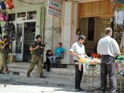 Open-air market in city being patrolled by Israeli troops (2004).