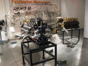 English: Porsche Indy engine and 16-Cylinder prototype engine in the Porsche-Museum. Deutsch: Porsche Indy Motor und ein 16-Zylinder Prototyp im Porsche-Museum.