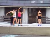 A small dance company rehearses for a performance on an outdoor stage in Stuyvesant Cove Park, Manhattan, New York City