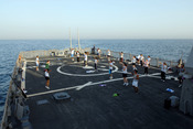 English: PERSIAN GULF (May 9, 2007) - Sailors participate in aerobics at sunset on the flight deck of Arleigh Burke-class Destroyer USS O'Kane (DDG 77) as part of the Navy's physical fitness program. O'Kane, as part of John C. Stennis Carrier Strike Group