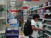 English: A shopper in a Duane Reade aisle.