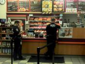 English: Two NYPD cops in a Dunkin Donuts on Houston Street in the East Village.