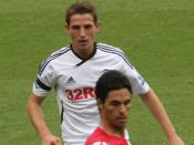 Joe Allen and Ashley Williams of Swansea defend against Mikel Arteta of Arsenal