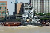 English: The towboat, Donna York, pushing barges of coal up the Ohio river. The tow had just exited the Portland canal at Louisville, Kentucky.