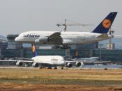 Two Airbus A380 and a Boeing 747 aircraft at Frankfurt Airport