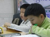 English: Two students studying English at a Taiwanese cram school (buxiban).