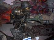A statue of a Viet Minh soldier holding a Lunge Anti-Tank Mine. Photo taken from the Vietnam Military History Museum, Hanoi, Vietnam.