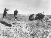Nazi soldier murdering Jewish civilians, including a mother and child, in 1942, at Ivangorod, Ukraine.