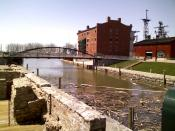 English: Erie Canal Commercial Slip. Note lattice masts of museum ship USS Little Rock in background.