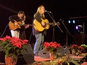English: Grammy-award winning country music star Mary Chapin Carpenter (right) entertains airmen and family members at Aviano Air Base, Italy, December 21st. Guitarist John Jennings and singer Mary Ann Redmond accompany Chapin Carpenter.