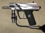 A Kingman Spyder VS1 paintball marker that has been unanodized to show the aluminum
