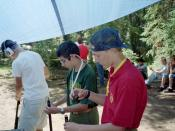 Varsity Scouts preparing black powder rifles as part of a Frontiersman activity.