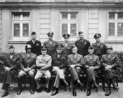 English: Senior American military officials of World War II. Seated are (from left to right) Gens. , George S. Patton, , Dwight D. Eisenhower, Omar Bradley, , and ; standing are (from left to right) Gens. Ralph F. Stearley, , , , and . colon