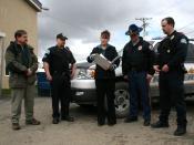 English: Alaska Public Safety Commissioner Walt Monegan (left) with Alaska State Troopers and Alaska Governor Sarah Palin (center).
