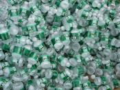 A large pile of half-pint Poland Spring bottles